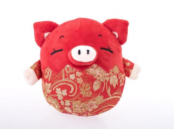 Chinesische Schweinepuppe mit Glückssymbolen