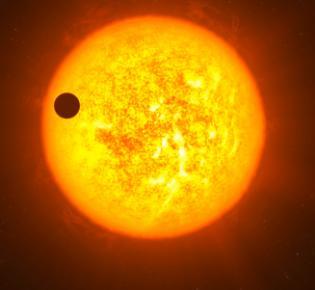 Transit eines Exoplaneten vor seinem Stern.