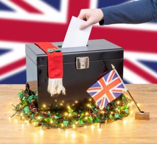 Wahlurne mit Weihnachtsdeko vor Union Jack