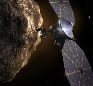 """Künstlerische Darstellung der an einem Jupiter-Trojaner vorbeifliegenden NASA-Raumsonde """"Lucy"""""""