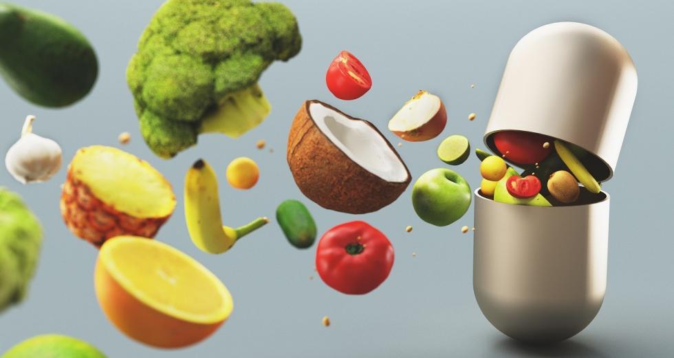Vitaminkapsel, aus der Obst und Gemüse herausströmen