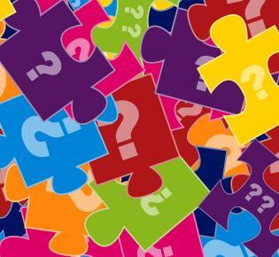 Bunte Puzzleteile mit Fragezeichen